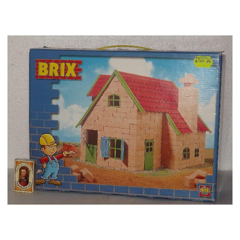 Byggesæt indeholder, forme og mix til støbning af mursten, lim, sand, målebæger og instruktioner