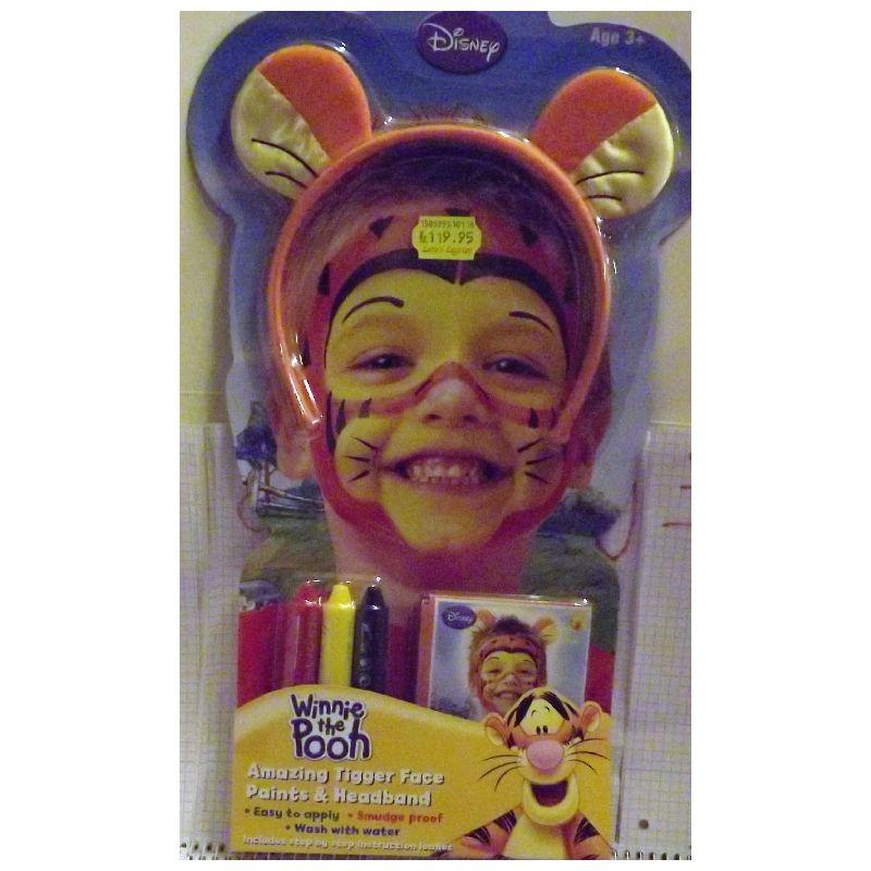 Tigerdyrets �rer p� pandeb�nd. 3 farver til at sminke sig  med.  Kl�de dig ud som tigerdyret. Kan bruges til leg eller som  h�rb�jle.