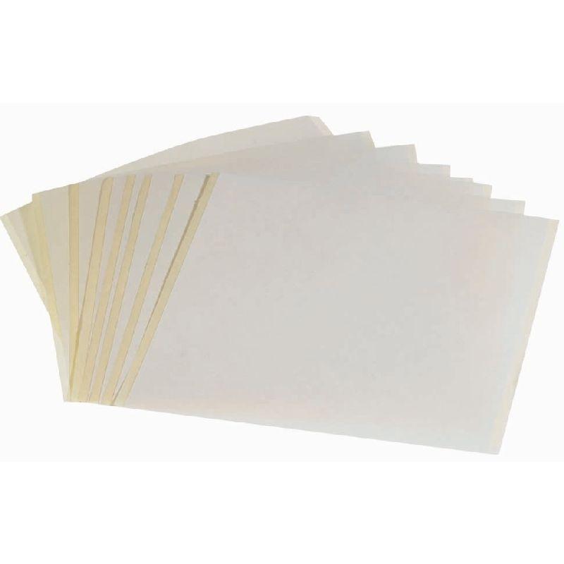 Brug dobletklæben tape fra Photo Pearls® og slip for at  stryge dinne perler.